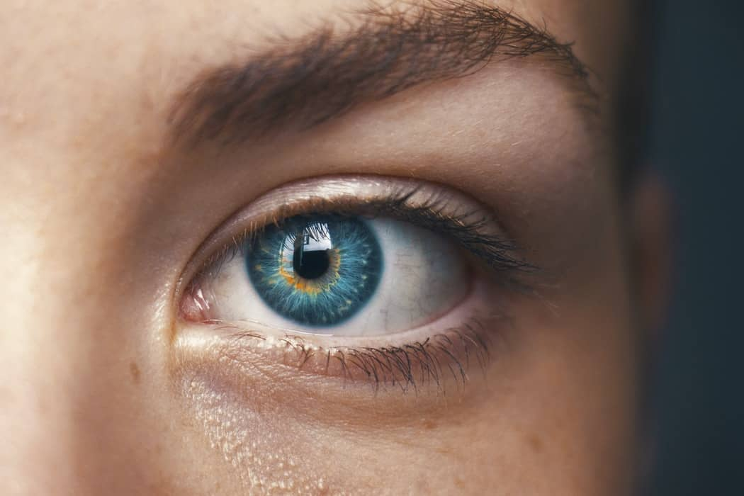 Human eye, blue with pronounced golden yellow streaks.